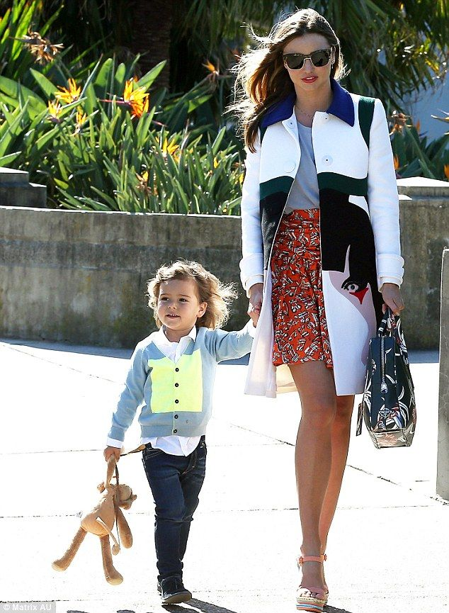 Model godmother! Miranda Kerr steps out in orange floral skirt with smiley son Flynn to attend friend's baby shower | Mail Online