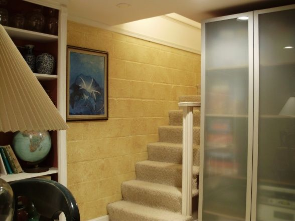 the stairs showcases the finish on the block wall basements design