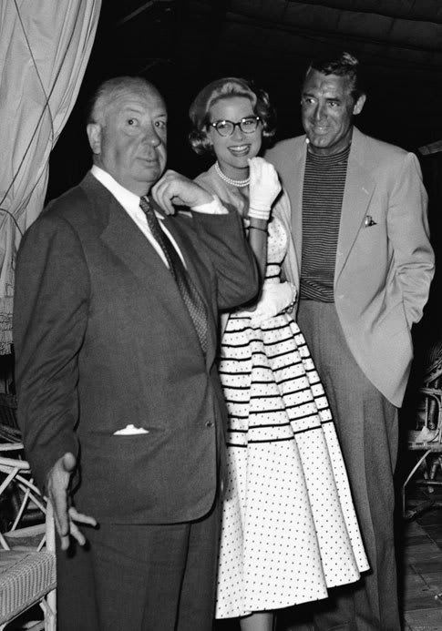 Alfred Hitchcock, Grace Kelly, and Cary Grant at a cocktail party in Cannes during the filming of To Catch a Thief.