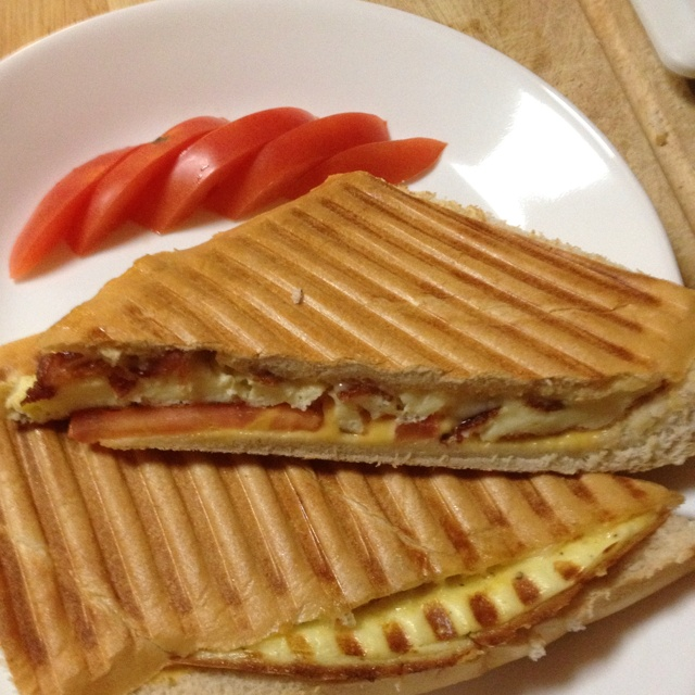 Panini.. Frittata eggs, crispy smoked bacon, Swiss and American ...