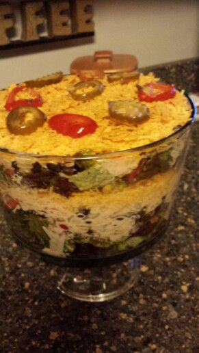 layer tex mex salad. Lettuce, beans, onion chips tomatoes ranch ...