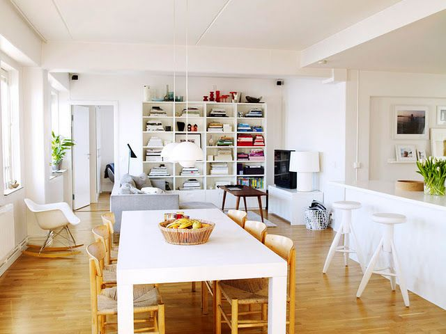 white dining table, wood chairs, white console for TV and wood coffee table.