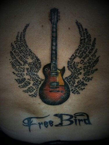 free bird tattoo favorite song by lynyrd skynyrd love how the lyrics make up the wings of the. Black Bedroom Furniture Sets. Home Design Ideas
