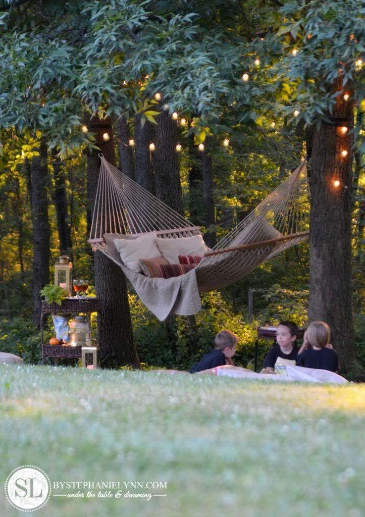 Backyard Hammock Setup :  lights above the hammock and the drink amp snack stand set up nearby