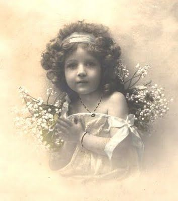 Little girl with lilies-of-the-valley