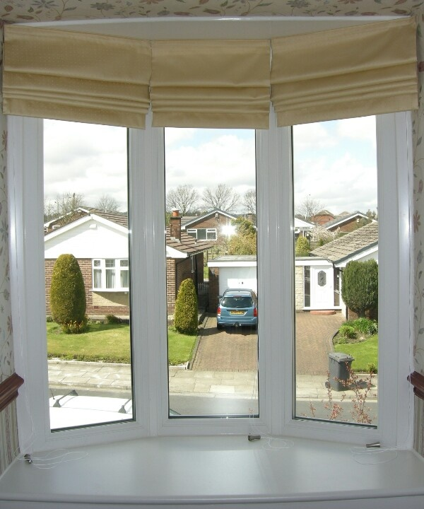 Roman blinds for bay window doors pinterest for Roman shades for bay window