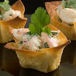 Appetizers of shrimp salad made with lime, curry, mango chutney, and ...