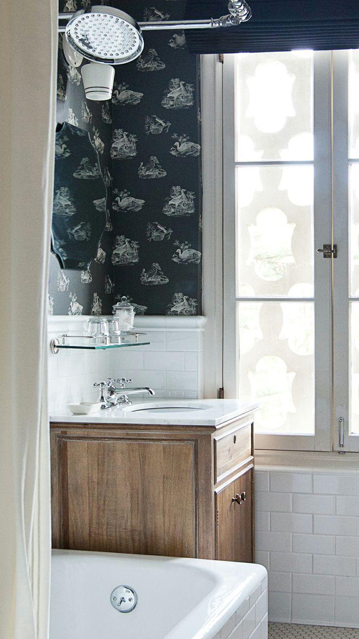 Pedestal sinks and rain showers make bathrooms feel indulgent.