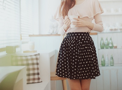 Black with white Polka dot umbrella skirt. Contrasted with soft pale cream/pink flounced long sleeve top.