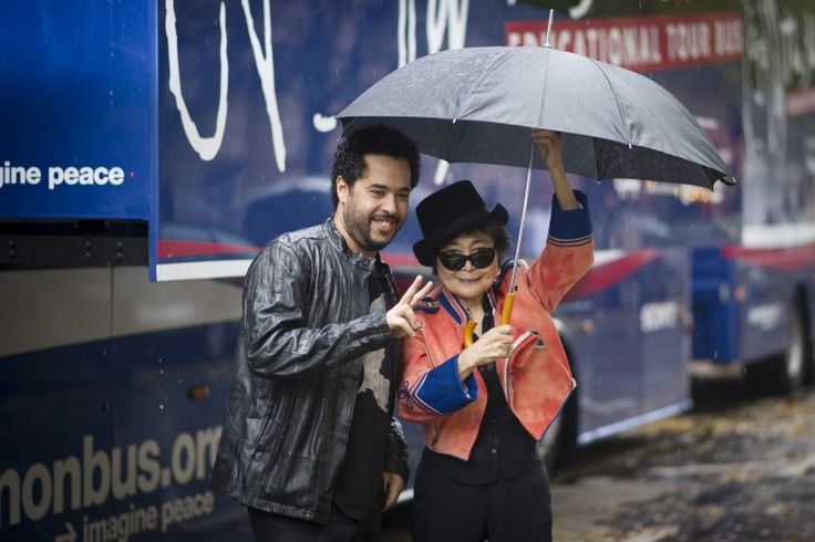 Raindrops keep falling on their heads. German singer Adel Tawil and Yoko Ono find shelter from (and peace in) the rain while attending a photo call for the John Lennon Educational Tour Bus on Oct. 15 in Berlin