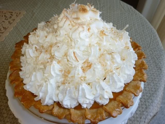 Mile high sweet potatoe pie w/ whipped cream and roasted marshmallows.