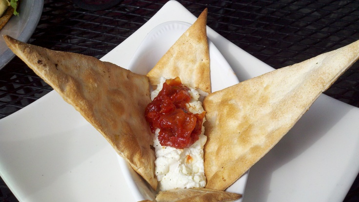 ... goat cheese baked and topped with Tomato chutney and served with