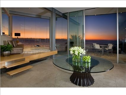 Beautiful floor to ceiling windows and a stunning sunset to admire.