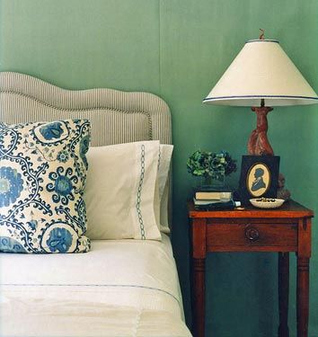 Green Blue' by Farrow & Ball: Bedroom designed by Annsley McAleer  Designer Annsley McAleer's Boston bedroom, featured in Domino. The walls are painted Blue Green by Farrow & Ball. The headboard is upholstered in ticking stripe fabric. Photo by Justin Bernhaut, Domino, April 2007.