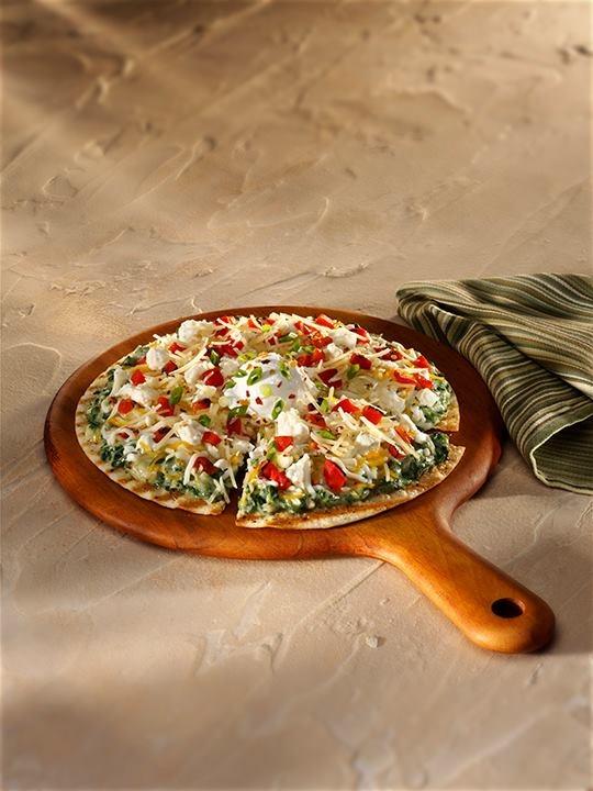 artichoke dip, garlic, diced and sundried tomatoes, Parmesan and feta ...