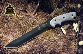 Cutting: TOPS Knives Anaconda Tanto Point Knife.   DESIGNED BY RON HOOD OF 'HOODS WOODS' THIS KNIFE HAS BEEN AROUND THE WORLD AND PROVEN ITSELF FROM THE AFRICAN JUNGLES TO THE ALASKAN FRONTIER...ITS UNIQUE DESIGN ENABLES THE USER TO ENHANCE THE DOWNWARD STROKE OF THE KNIFE BY THE ANGULAR RELATIONSHIP TO THE STURDY HANDLE.   RON HOOD'S EXPERIENCES HAVE MADE HIM A HIGHLY RESPECTED AUTHORITY IN THE SURVIVAL COMMUNITY, WORLDWIDE. HIS EXPERIENCES HAVE ENABLED THE 'ANACONDA' DESIGN, TO BE A 'FIELD ...