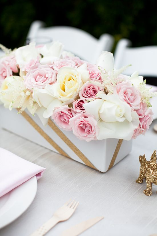 this is romantic and soft color choice , i think the flowers are arranged very messy though. The gold trim truly gives it that extra special something.
