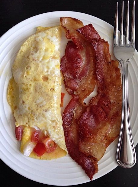 Pepper, onion, tomato, and cheddar omelette with Canadian bacon