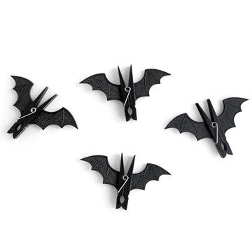 Spooky Bats Pegs: make these with black-painted clothes pins and card stock cutout bat wings. Use them for party favors, decorations, shadow playing...simple yet very useful! #Halloween