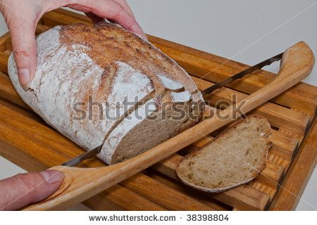 ... organic artisan loaf of kamut flour bread on a bread board with knife