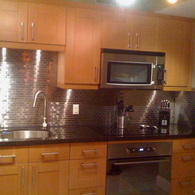 ikea kitchen i made with stainless steel backsplash