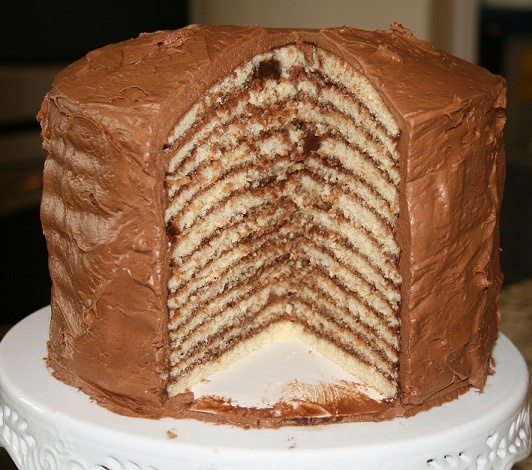 yellow cake with chocolate glaze in between layers and a chocolate ...