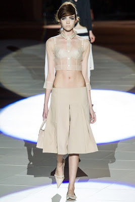 Marc Jacobs Bare & Bold for spring. Exposing the midriff is back in as shown by just about everybody including Balenciaga, Versace, Louis Vuitton, Mui Mui...you name it. Start those crunches, girls.