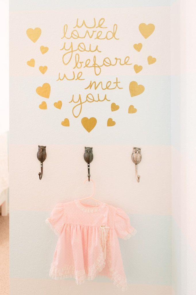 """""""We loved you before we met you."""" - super-sweet DIY wall decal in the nursery"""