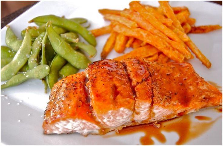 Pomegranate-orange glazed cedar salmon