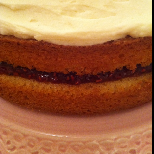 Almond sponge with raspberry jam filling and beurre noisette frosting