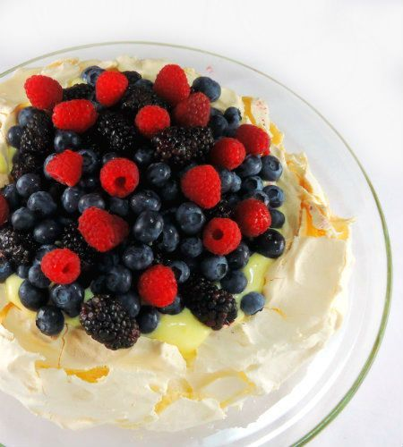 Pavlova with Lemon Curd and Mixed Berries.