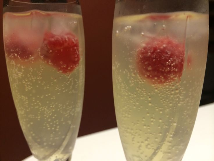 ... sparkling water. 1/4 cup of limoncello liqueur. Plus 2 raspberries. On