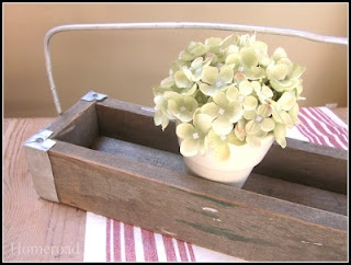 This was made from an old saw horse, and aluminum loaf pans!!!  You have to see the easy tutorial to see how it was done.  I would have NEVER thought to use these materials this way.  People are so creative!