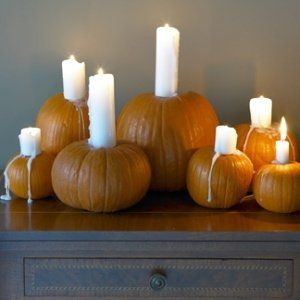 Pumpkins filled with dripping church candles Halloween front door decor