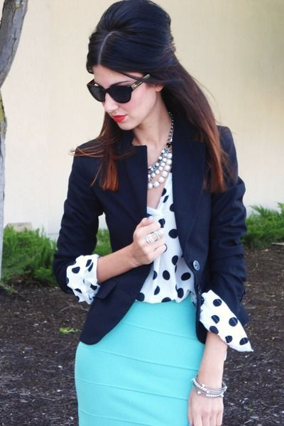 Aqua skirt, black and white polka dot top, navy sweater coat.