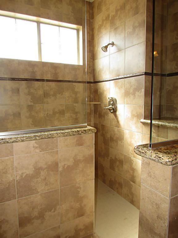 Huge walk in shower half wall half glass current shower for Walk in shower walls