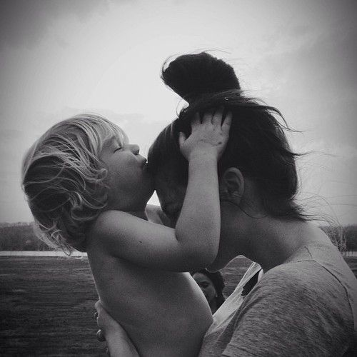 """karrinainoregon:    Bekah and Little.    This picture makes my heart skip a beat because it captures the sweetest game little plays with me. He asks """"where's your fwavwet pwace for tiss?"""" I always say forehead then he asks for second favorite etc and I end up getting little kisses all over my face and usually even the top of my head. I'm the luckiest."""