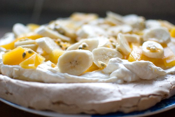My favourite cake, a winter pavlova with lemon curd and fresh fruit.