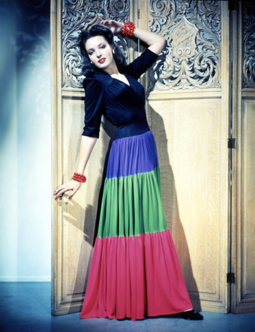 {Amazing how styles and trends come back around...} Linda Darnell in 1940s tiered gypsy dress with colour blocking and ruched bodice