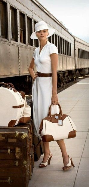 Have to pin this as I find it so incongruous, an illusion of travel.  I love fashion passionately, and wear nice clothes on holidays.  But seriously ... WHITE on a train??? Those shoes and that bag? Only if you're travelling with paid help, I think!  Soot is soot! Even on First Class ... you still have to board at the station!
