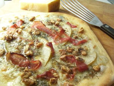 Prosciutto, pear and gorgonzola pizza with toasted walnuts and honey.
