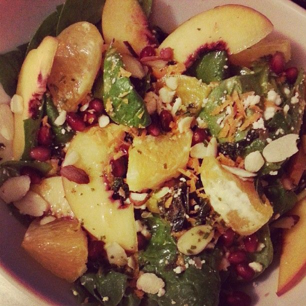 Spinach and kale salad, with golden beets, peaches, orange ...