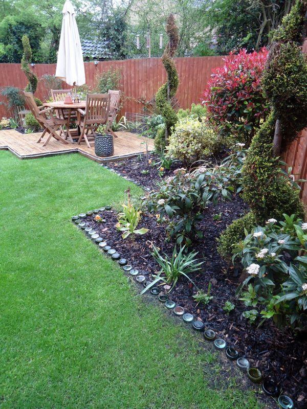 Glass bottle garden border edging garden ideas pinterest for Bottle garden ideas