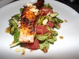 Salmon with toasted almonds and grapefruit and watercress salad