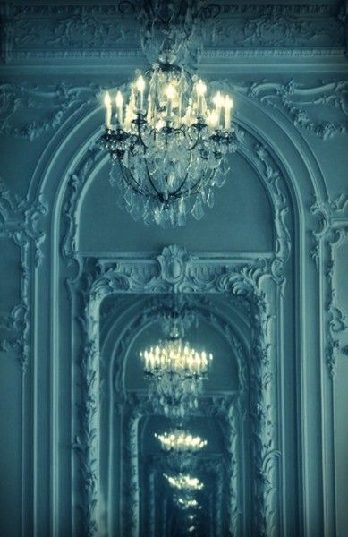 chandeliers in mirrors