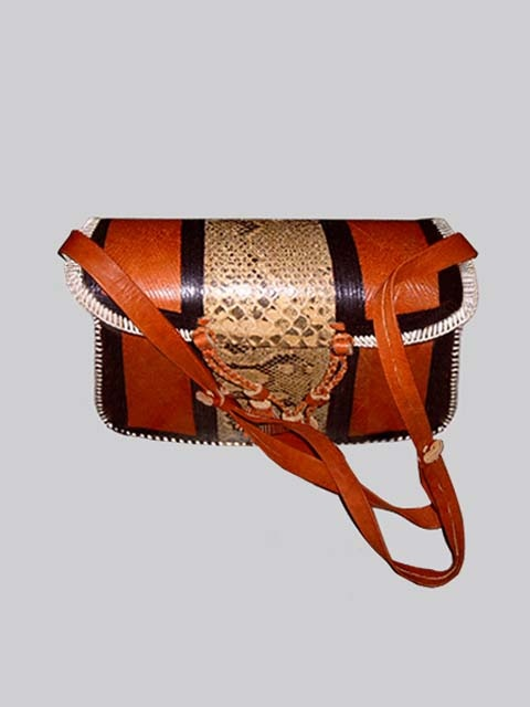 Exquisitely designed cured leather bag with black band. http://www.afrikboutik.com/apparel-and-jewelry/leather-bags/leather-bag-designer-1.html