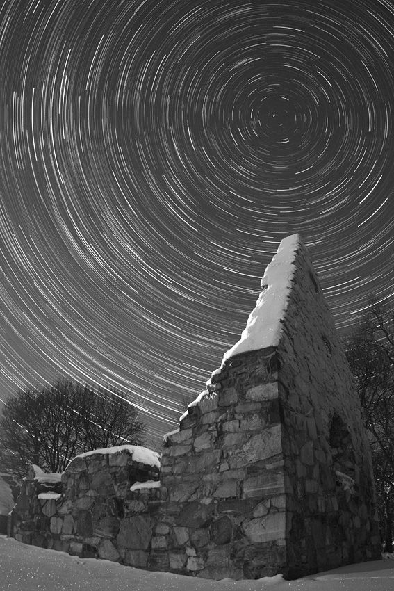 """Star Trails  over ruined Viking church in Vallentuna Sweden. [Image Credit & Copyright: P-M Hedén (Clear Skies, TWAN)] Polaris is at the center of the circular trails and you can also see a Geminid meteor cutting across the star trails. ©Mona Evans, """"Polaris -10 Fascinating Facts"""" http://www.bellaonline.com/articles/art178625.asp"""