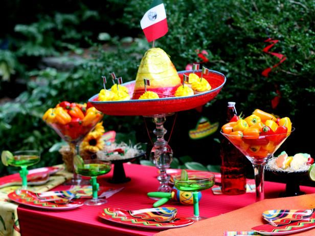 I like the colorful hot peppers in the large martini/margarita glass centerpiece idea here.