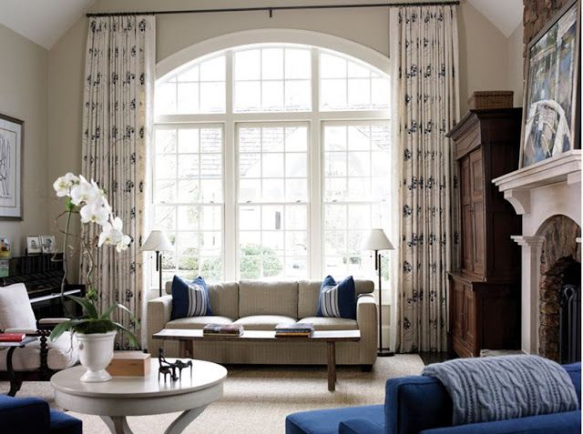 nice draperies over arched window living room window