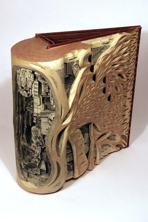 insane art carved into vintage medical books